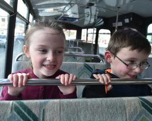 Ready for a ride on the Otago Museum's school holiday bus route are Kyla (7) and Toby (6) Rae, of...