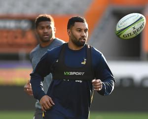 Highlanders first five-eighth Lima Sopoaga, with winger Waisake Naholo in the background, trains...