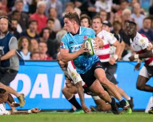 Waratahs flanker Michael Hooper carries the ball during their last match against the Lions. Photo...