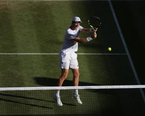 Michael Venus in action on the way to the Wimbledon final. Photo: Getty Images