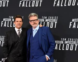 Actor Tom Cruise and director McQuarrie arrive for Mission:Impossible film premiere in Washington...