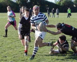 Otago Boys' High School first five-eighth Tevita Asi breaks through the Waitaki Boys' High School...
