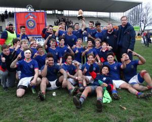 A jubilant St Kevin's College First XV celebrates its annual interschool win over Waitaki Boys'...