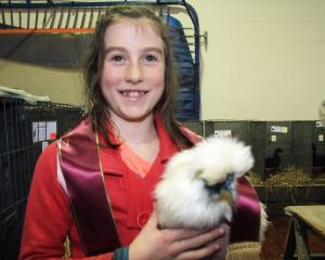 Jennifer Keen, of Winton, holds her best light breed-winning chook. Photos: Hamish MacLean