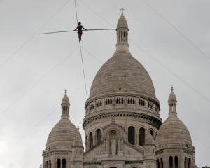 Tatiana-Mosio Bongonga advances on a tightrope as she scales the Monmartre hill towards the Sacre...