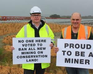 Peter O'Sullivan (left) and Peter Haddock prepare for the protest at the Taramakau Bridge...