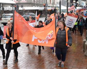 Strikes and protest marches, such as this one by PSA members working at Inland Revenue in Dunedin...
