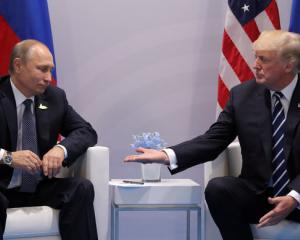 US President Donald Trump (right) meets with Russian President Vladimir Putin during their...