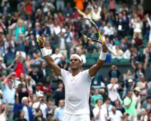 Rafael Nadal celebrates his win in the Wimbledon quarterfinals. Photo: Getty Images