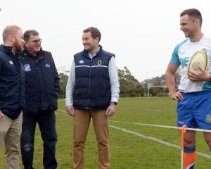 ORFU club and schools liaison officer Simon Wallace (left) discusses sideline etiquette with...