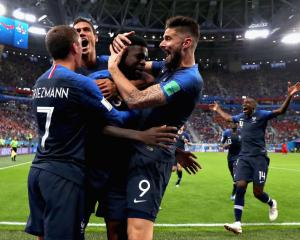 Samuel Umtiti is mobbed by French team mates after putting his side up 1-0 in their World Cup...