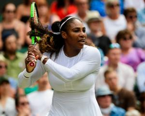 Serena Williams plays a backhand during her semifinal win over Julia Goerges at Wimbledon. Photo:...