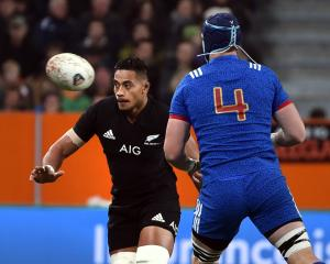 All Black loose forward Shannon Frizell looks towards the action along with French lock Bernard...