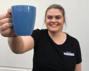 Potpourri Vegetarian Cafe barista India Smith, of Dunedin, displays a ceramic mug from a mug...