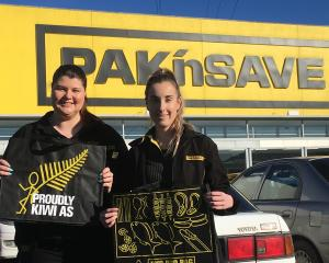 Pak'nSave checkout manager Alyse McDonald (left) and scan co-ordinator Tori Kater hold reusable...