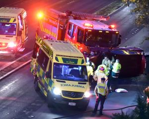 St John Ambulance officers, firefighters and police join forces to help at the scene of a fatal...