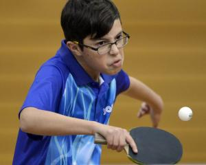 Jayden Ralston (Canterbury) in action during a BS13 match at the Otago Table Tennis Open held in...