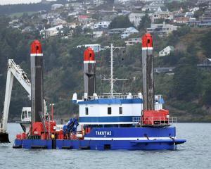 New dredge Takutai takes a short cruise on Otago Harbour for training yesterday. PHOTO: STEPHEN...