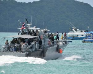 A Thai Royal Navy boat is seen during a searching operation for missing passengers of a capsized...