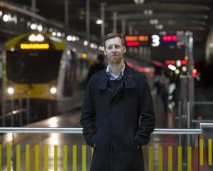 Greg Bruce at the station. He catches the same 7.37 train to work every day. Photos: NZME