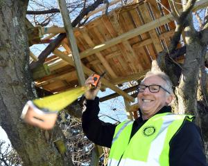 Mosgiel Rotary Club member Peter Seddon prepares to take the final measurements of the treehouse...