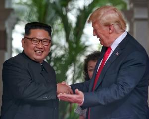 North Korean leader Kim Jong-Un and US President Donald Trump at their historic summit in...