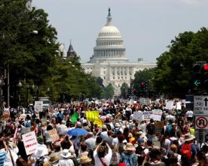 Immigration activists march to protest the Trump Administration's immigration policy in...