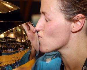 Captain Wendy Frew celebrates after the Southern Steel won netball's national premiership...