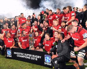 The Crusaders squad celebrates with the trophy after the win. Photos: Reuters