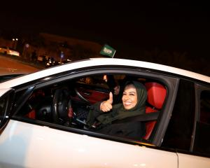 A Saudi woman behind the wheel of her car in Al Khobar, Saudi Arabia on June 24, the day women...