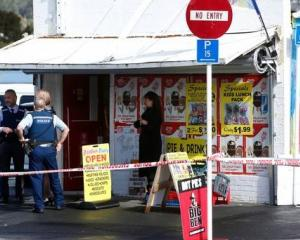 Police investigate the robbery at the Rainbow Dairy in Whangarei. Photo: NZ Herald