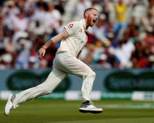 England's Ben Stokes celebrates the wicket of India's Mohammed Shami. Photo: Reuters