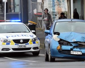 Police attend a crash at the corner of Carroll and Princes Sts this morning. Photo: Peter McIntosh