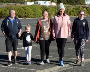 Terminal bowel cancer patient Toni Adie-Kinraid (centre) with (from left) husband Shaun Adie...