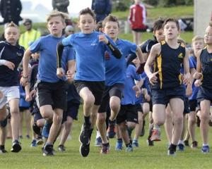 Runners take off from the start line of the boys year 5 and 6 race of the Ariki Cup at Kettle...