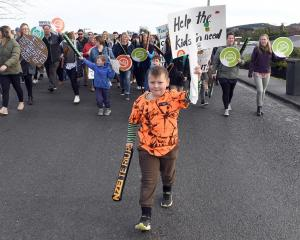 St Mary's Primary School pupil Sam Clark (8), son of teacher Lyn Clark, leads the strike march in...