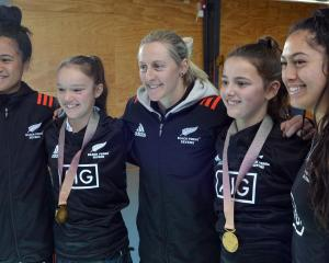 Black Ferns Sevens players (from left) Alena Saili, Kelly Brazier and Tenika Willison and the two...