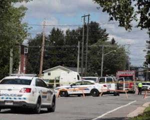 Police are present at the scene of a shooting incident in Fredericton. Photo: Reuters