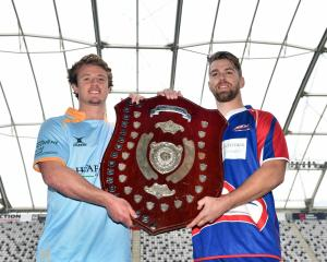 University captain Jack McHugh (left) and Harbour skipper Charles Elton get to touch  the prize...