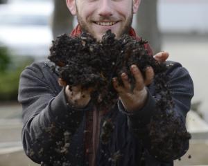 Student Finn Boyle runs his hands through some soil at the Otago Polytechnic yesterday. Photo:...