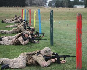 Territorial soldiers from Otago and Southland try out Mars-L assault rifles at an annual training...