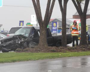 A ute stopped next to a tree after a crash in Invercargill this afternoon. Photo: Sharon Reece
