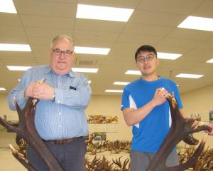 World of Deer Museum founders Clive Jermy and Harry Yu with the replica of a record set of...