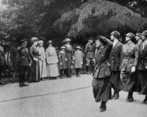 Women mechanical transport drivers marching past a royal party at Aldershot, comprising the King,...