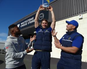 Otago Mitre 10 Cup lock Tom Rowe hoists a 4kg circle of Whitestone Cheese's Ohau Goat's Blue...