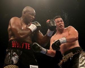 Joseph Parker takes a hit by Dillian Whyte during his loss to the Englishman last month. Photo:...