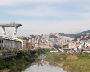 The remains of the Morandi motorway bridge stand after it partially collapsed in Genoa. Photo: Getty