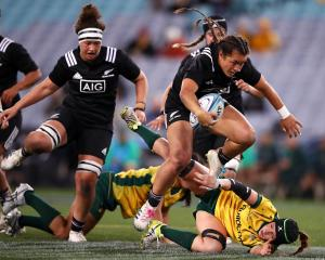 Theresa Fitzpatrick of the Black Ferns jumps over a Wallaroos defender. Photo: Getty Images