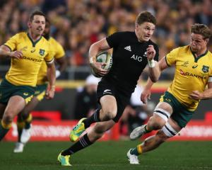 Beauden Barrett dashes away from Wallabies captain Michael Hooper in the first Bledisloe Cup Test...
