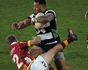 Pasqualle Dunn of Hawkes Bay runs over the top of Broc Hooper of Southland during the round one...